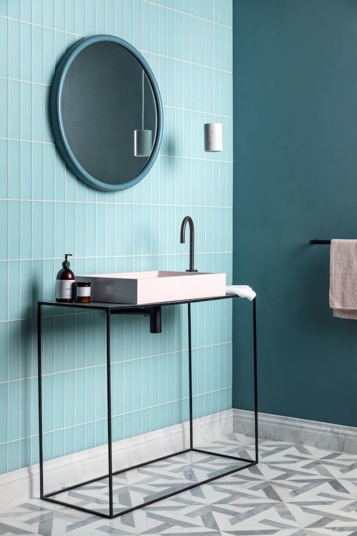 blue mint green tiles on the wall behind the sink with mirror bathroom wall tile ideas gray and white tiles on the floor with geometrical pattern