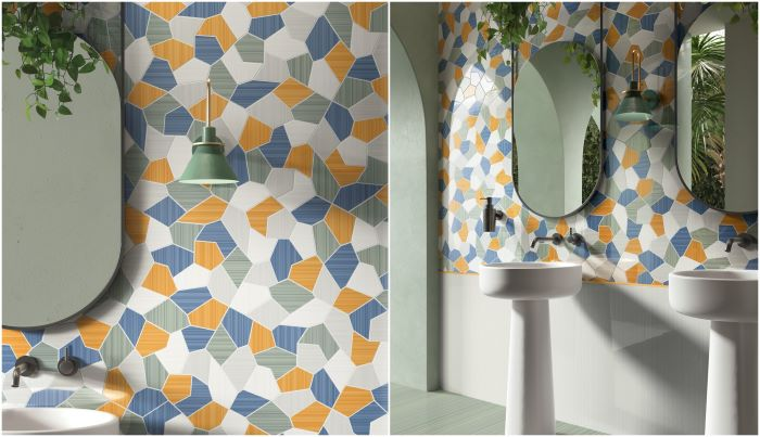 blue orange and white mosaic ceramic tiles in bathroom with two sinks two mirrors