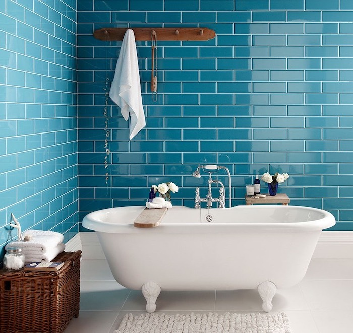 blue subway tiles on the walls behind vintage bathtub best flooring for bathroom white tiles on the floor