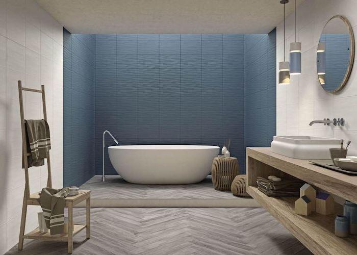 blue tiles on the wall behind the bathtub white tiles on the rest of the walls best flooring for bathroom wooden tiles on the floor