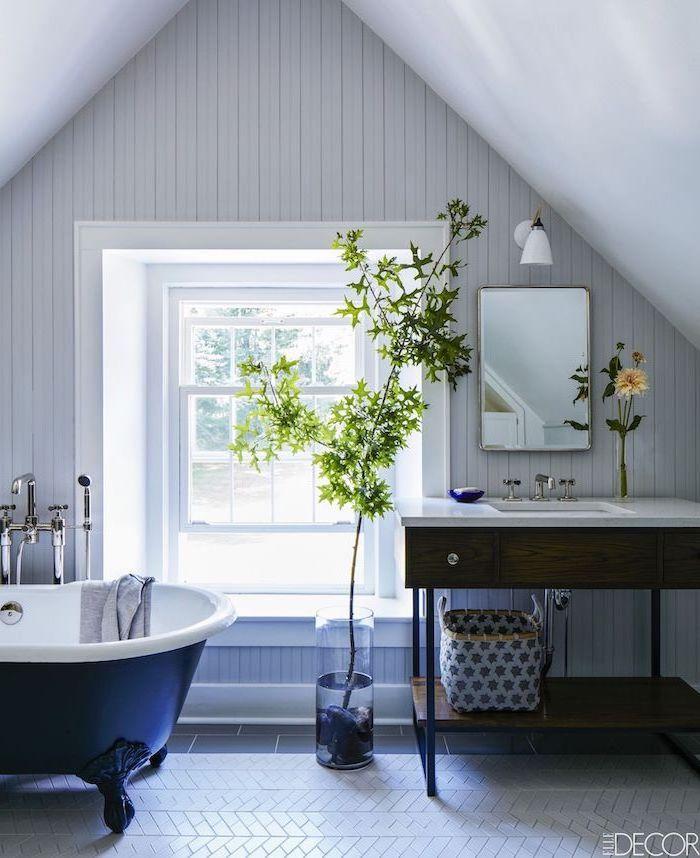 blue white vintage bath farmhouse bathroom tile white shiplap on the walls wooden vanity with open shelving