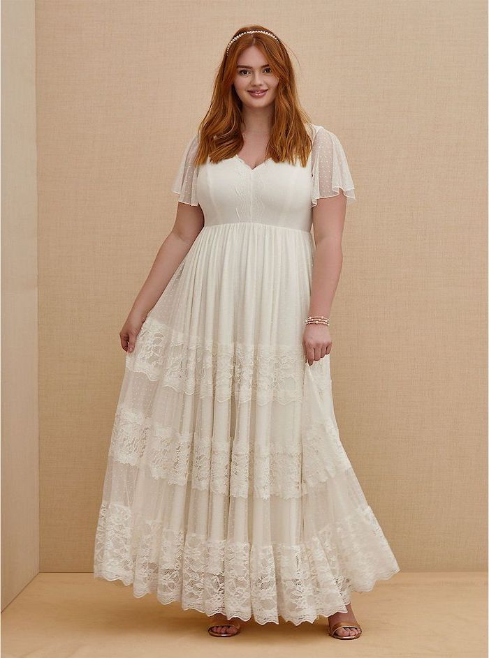 boho wedding dress white lace dress with short sleeves worn by woman with ginger hair wearing beige sandals