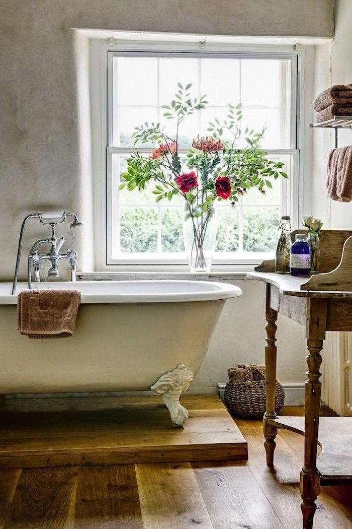 bouquet of flowers on the window frame next to vintage bath country bahtoom ideas wooden floor vanity with open shelving