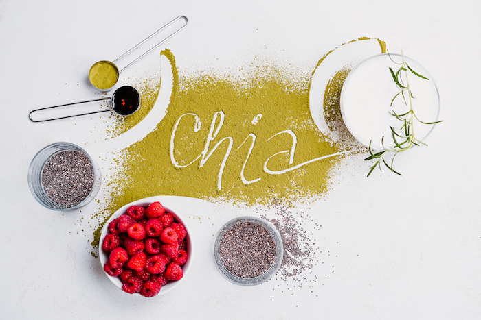 chia written with matcha powder easy vegan appetizers bowl with ingredients around it placed on white surface