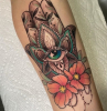 colorful hamsa hand with all seeing eye flowers tattoos with meaning of life forearm tattoo