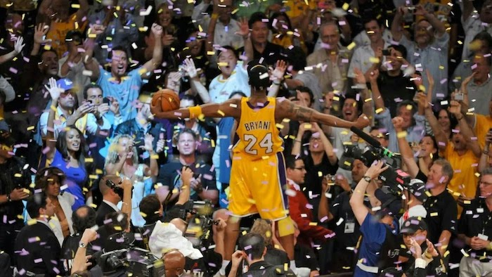 cool nba wallpapers kobe bryant standing on announcers table crowd looking at him holding a basketball