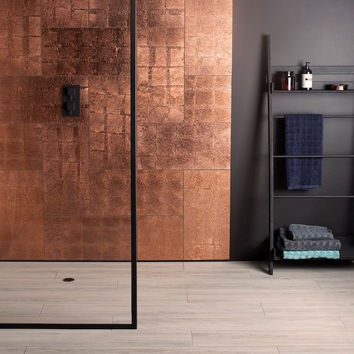 copper tiles on the wall under the shower tile shower ideas for small bathrooms the rest of the wall in black wooden tiles on the floor