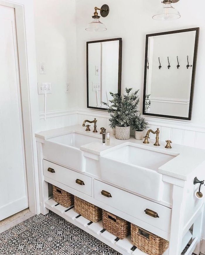 country bahtoom ideas white vanity with open shelving with baskets two sinks two mirrors black and white printed tiles