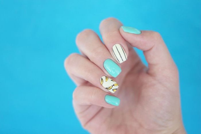 cute acrylic nail ideas blue and white nail polish yellow bananas decoration on ring finger