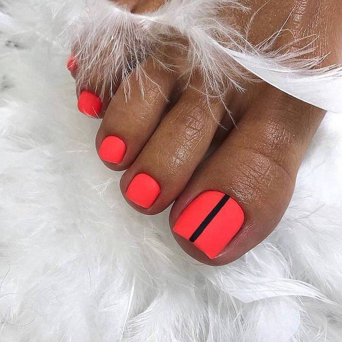 cute acrylic nails pedicure in neon pink matte nail polish one black line across the toe nail
