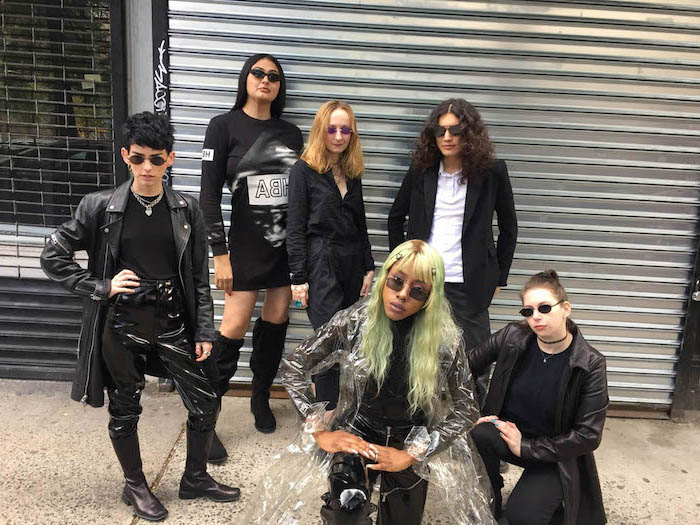 cute group halloween costumes six women dressed in all black as characters from the matrix wearing sunglasses