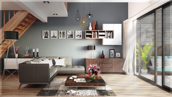 dark gray accent wall scandinavian decor gray corner sofa next to small square wooden coffee table rug on wooden floor