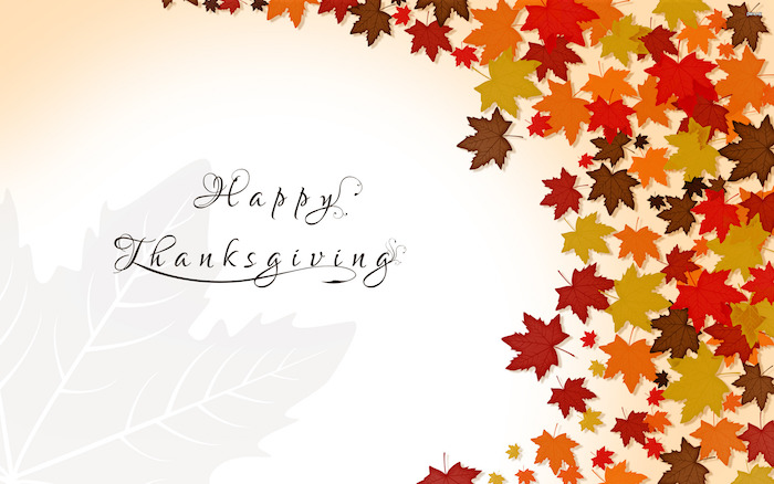 drawing of fall leaves in orange yellow red brown on the side cute thanksgiving wallpaper happy thanksgiving written in black cursive font