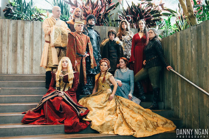 eleven people dressed as characters from game of thrones funny group halloween costumes standing on staircase