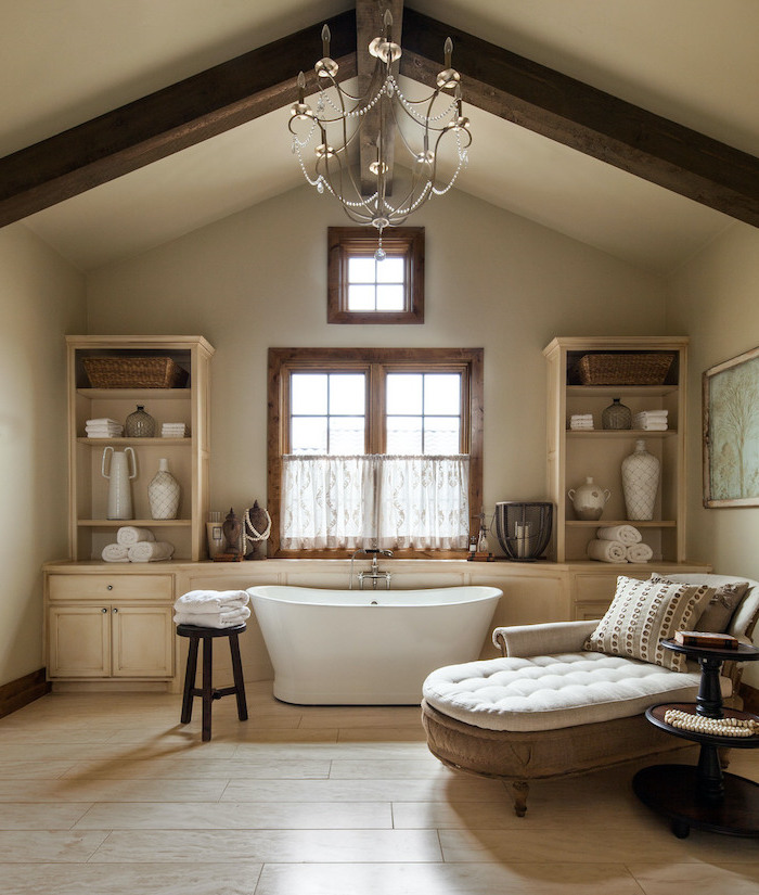 exposed wood beams on ceiling wood like tiles rustic bathroom decor bath in the middle armchair next to it
