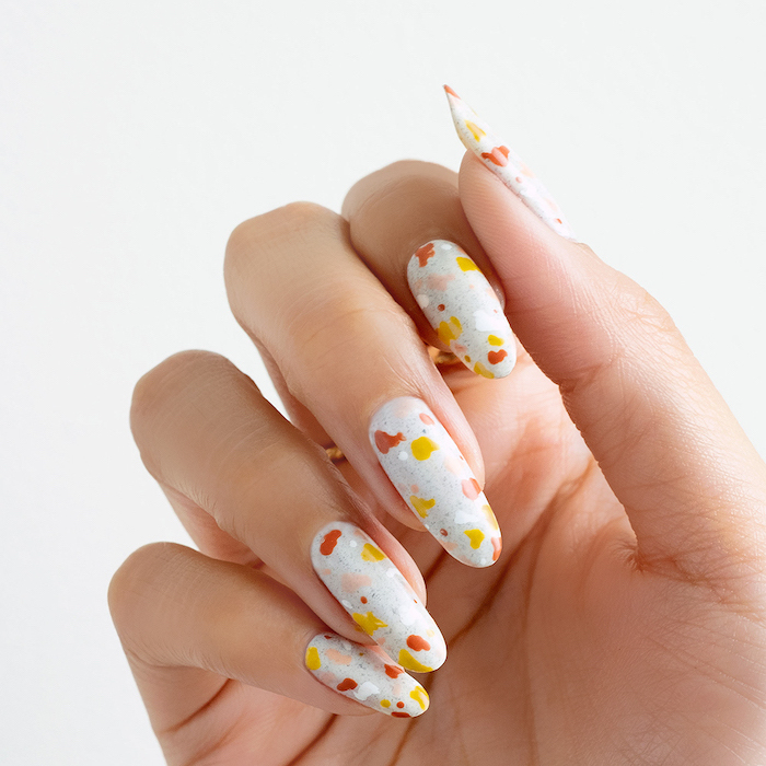 fall leaves in orange and yellow on white nail polish simple nail designs long almond nails