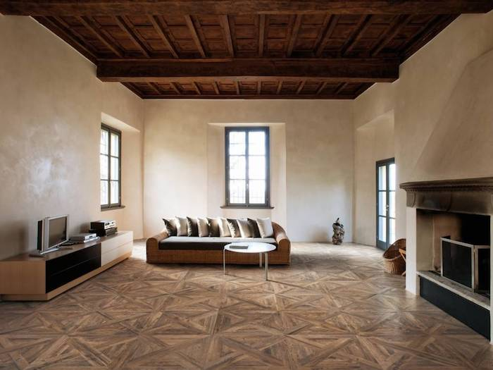 faux wood tiles on the floor exposed wood beams on the ceiling floor tiles minimalistic room design with white walls fireplace