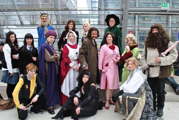 fifteen people all dressed as characters from the harry potter movies halloween costume ideas for girls posing together