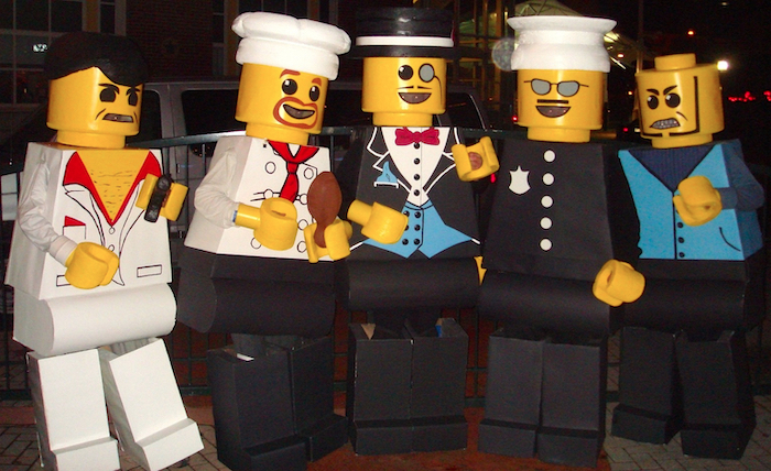 five people dressed as lego figurines girl group halloween costumes photographed together