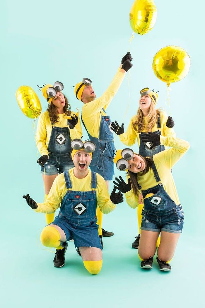 five people dressed as minions cute group halloween costumes denim overalls yellow blouses beanies