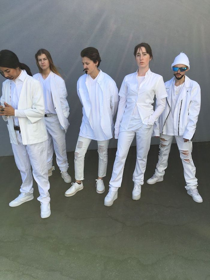 five women dressed as the backstreet boys group halloween costumes wearing white jeans shirts and jackets