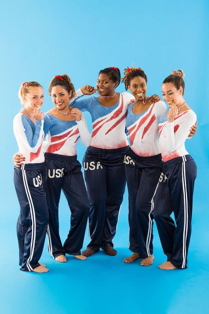 five women dressed as the usa gymnastics team holding the gold medal funny diy halloween costumes