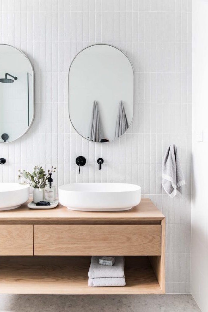 floating wooden vanity in bathroom scandinavian home decor two mirrors hanging on wall covered with white subway tiles