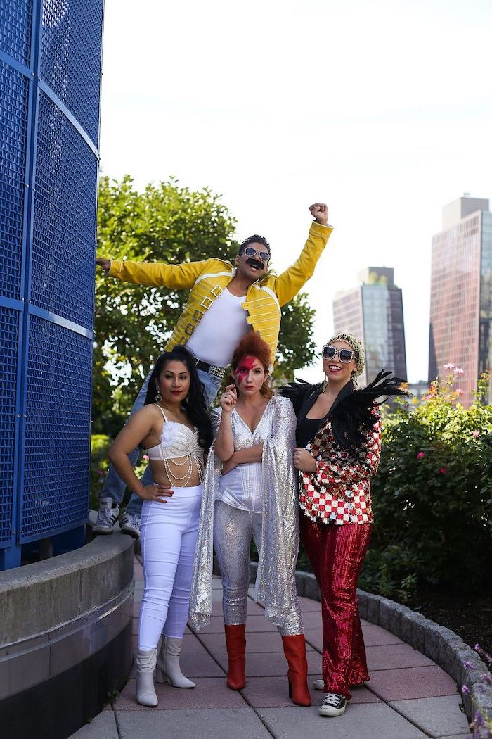 four people dressed as rock musicians legends from the nineties group halloween costumes for work