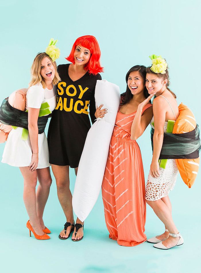 four women dressed as sushi and soy sauce funny group halloween costumes photographed on blue backgorund