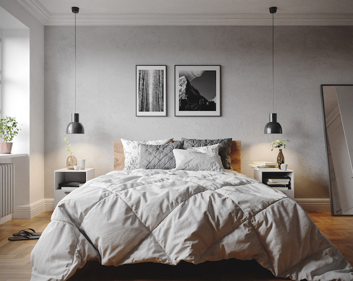 framed black and white photos above the bed scandinavian furniture wooden floor mirror leaning on the wall