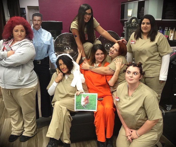 girl group halloween costumes seven women dressed as characters from orange is the new black in prison uniforms
