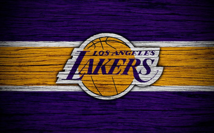 gold and purple background cool nba wallpapers los angeles lakers logo in purple and gold in the middle