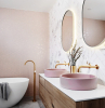 gold brass faucets pink sinks on wooden floating vanity best flooring for bathroom marble subway tiles behind sink pink mosaic tiles behind bathtub