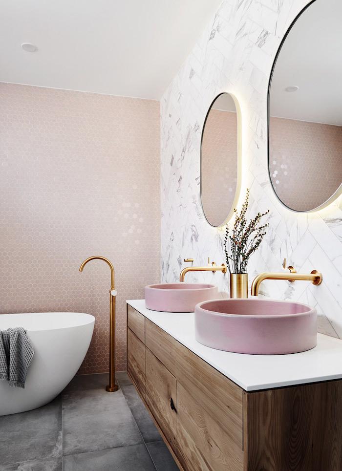 gold brass faucets pink sinks on wooden floating vanity best flooring for bathroom marble subway tiles behind sink pink mosaic tiles behind bathtub