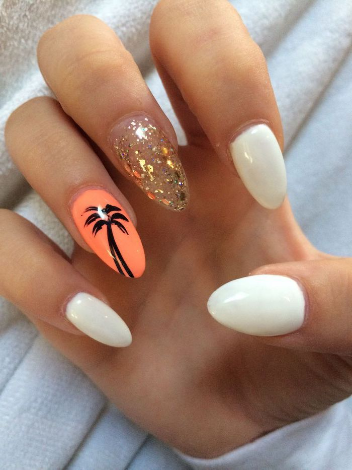 gold leaves decorations on middle finger orange flower with black palm on ring finger short acrylic nails white nail polish on almond shaped nails