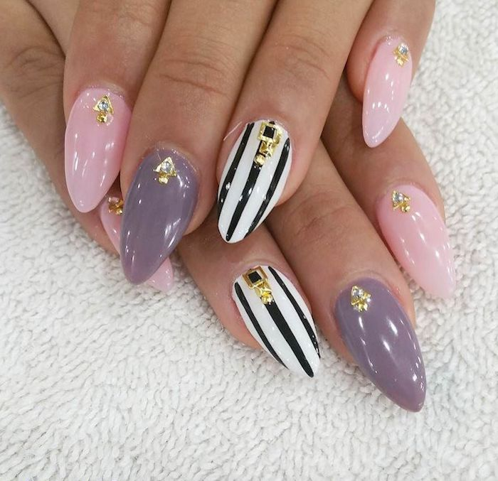 gray and pink nail polish with rhinestones short acrylic nails black and white stripes on ring fingers long nails with almond shape