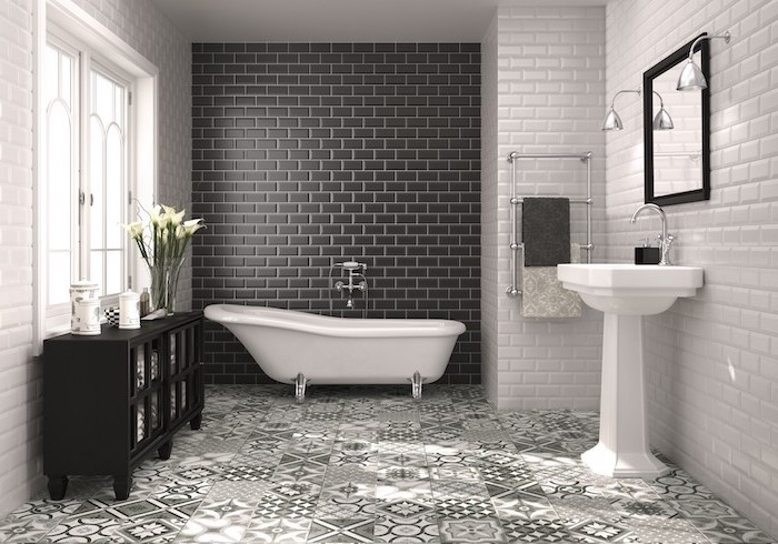 gray and white printed tiles on the floor black subway tiles accent wall behind the bathtub bathroom tile ideas white subway tiles on the rest of the walls