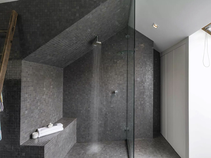 gray mosaic tiles under the shower separated with a glass bathroom wall tile ideas white walls in the rest of the bathroom
