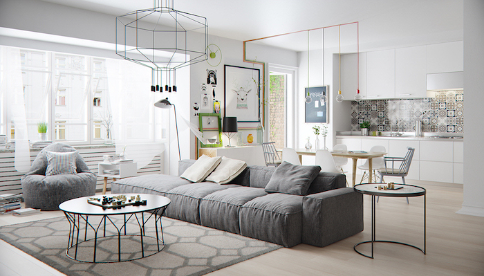 gray sofa and puff next to small round black metal coffee table scandinavian furniture kitchen in all white