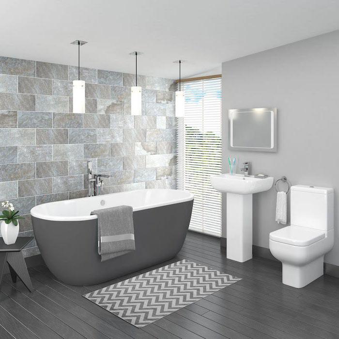 gray wooden tiles on the floor tile shower ideas for small bathrooms stone like tiles accent wall behind the bathtub