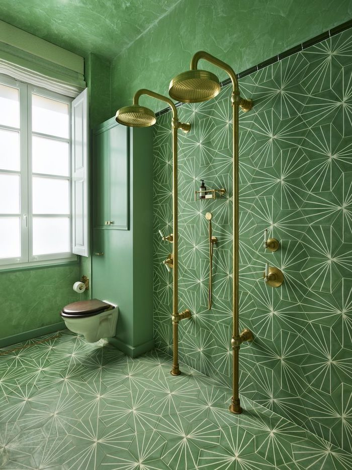 green honeycomb tiles on the floor and walls with white print bathroom shower tile ideas brass gold shower heads