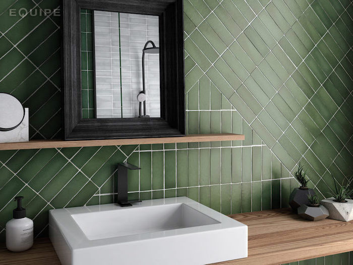 green tiles arranged in different directions on the wall behin the sink with wooden vanity how to tile a bathroom floor