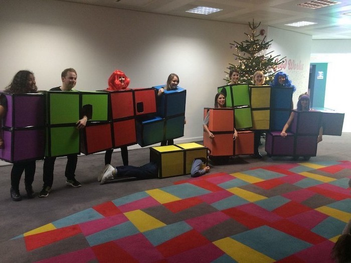 group halloween costumes for work ten people dressed as tetris pieces in different colors photographed in office lobby