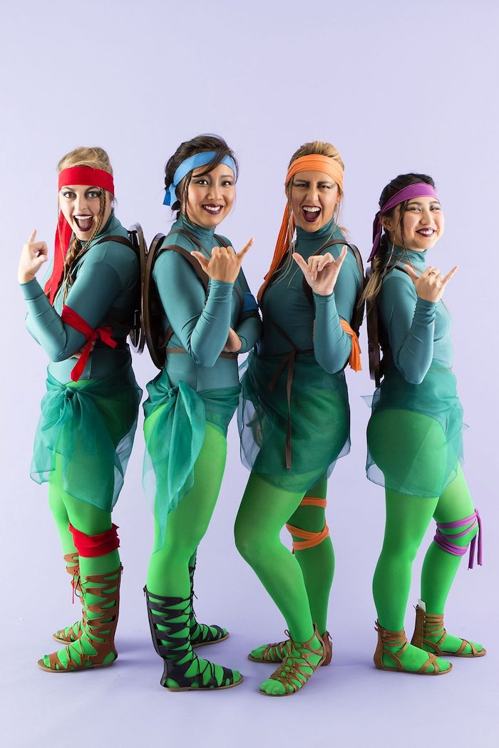 group halloween costumes four women dressed as teenage mutant ninja turtles with green tights and tops bandanas in different colors