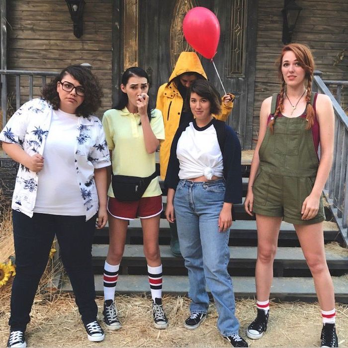 halloween costumes for 3 people five girls dressed as the characters from it standing in front of spooky house