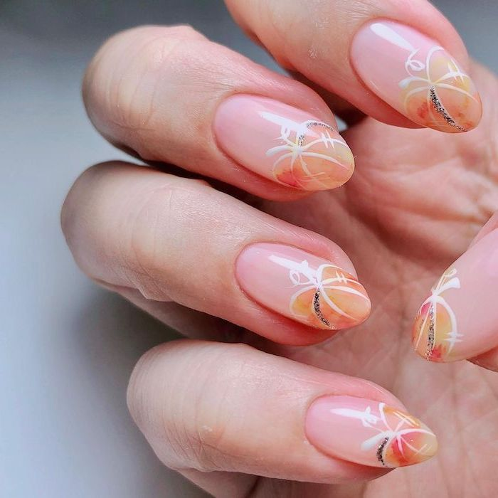 halloween themed nails almond shaped nails watercolor pumpkins with white silhouettes on nude nail polish