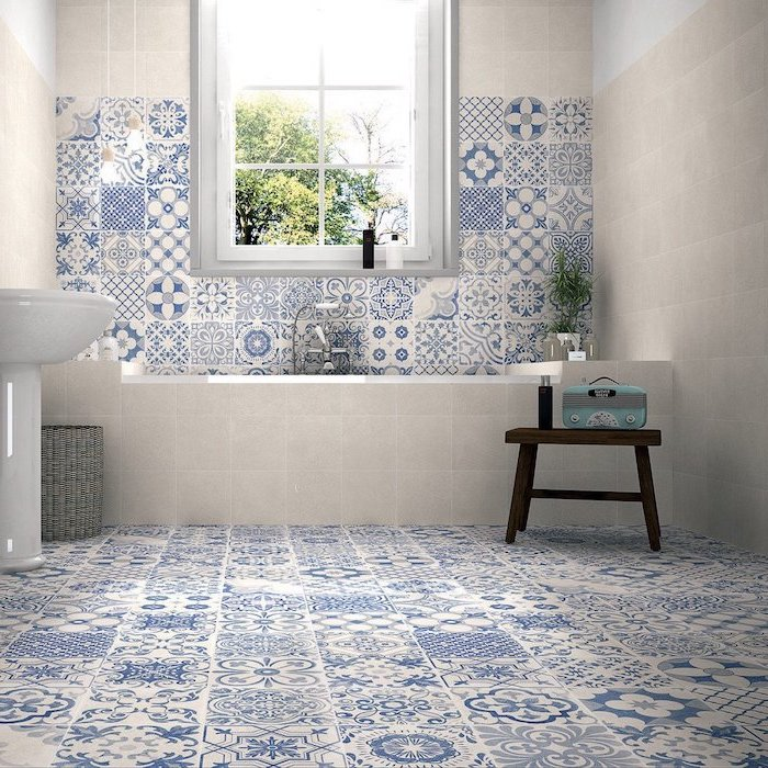 how to tile a bathroom floor blue and white tiles with print on the floor and half of the wall behind bathtub