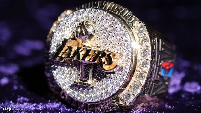 lakers wallpaper close up of the los angeles lakers championship ring placed on purple velvet covered surface