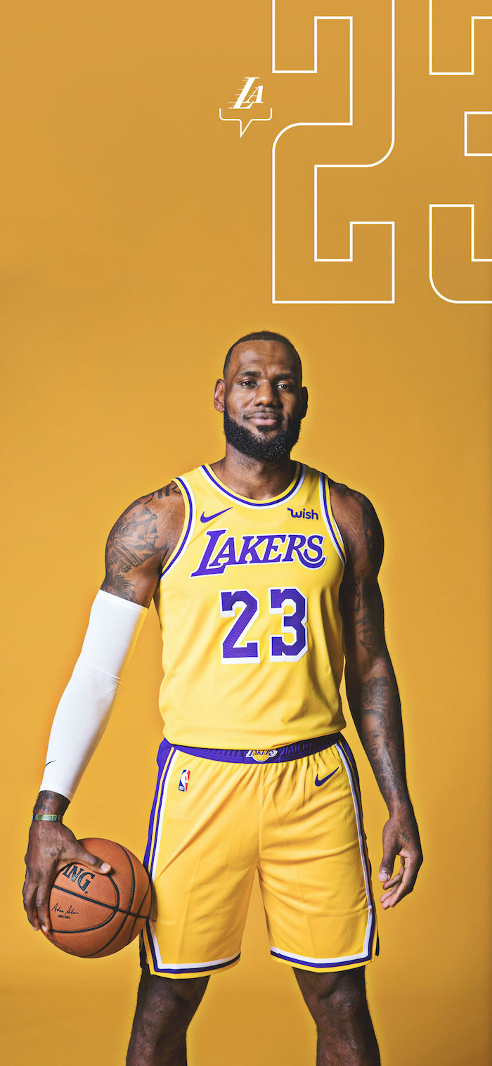 lakers wallpaper iphone lebron james wallpaper wearing gold lakers uniform holding basketball on yellow background