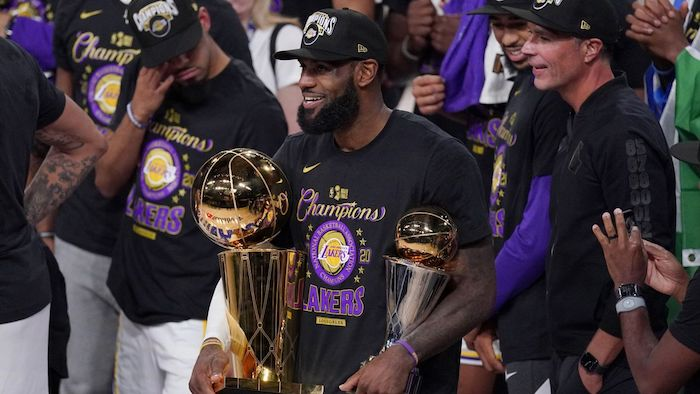 lebron james holding larry obrien trophy finals mvp trophy lakers wallpaper 2020 nba champions los angeles lakers